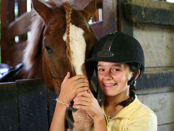 pretty girl smiling with braided horse