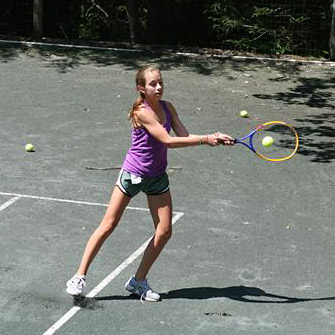 playing a game of tennis at summer camp