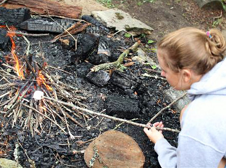 Learning to build a fire at summer camp