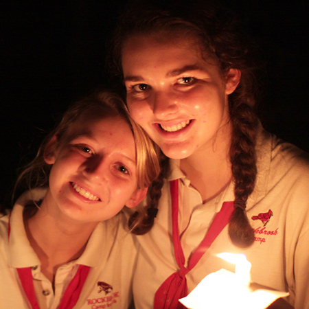 campers at spirit fire with candle