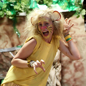 Lion costume girl at camp banquet