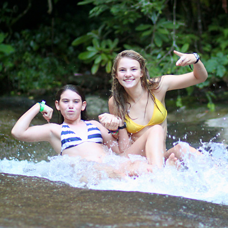 girls showing power on sliding rock
