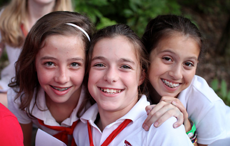 Smiling happy summer camp girls