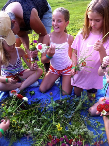 tiny camp girls picking flowers