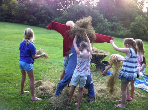 camp kids making a scarecrow