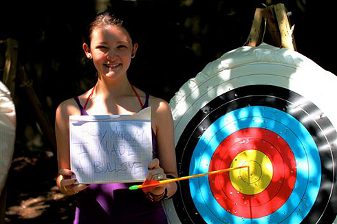 Camp girl hits bullseye in archery