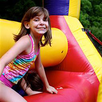 Camper on obstacle course during camp carnival