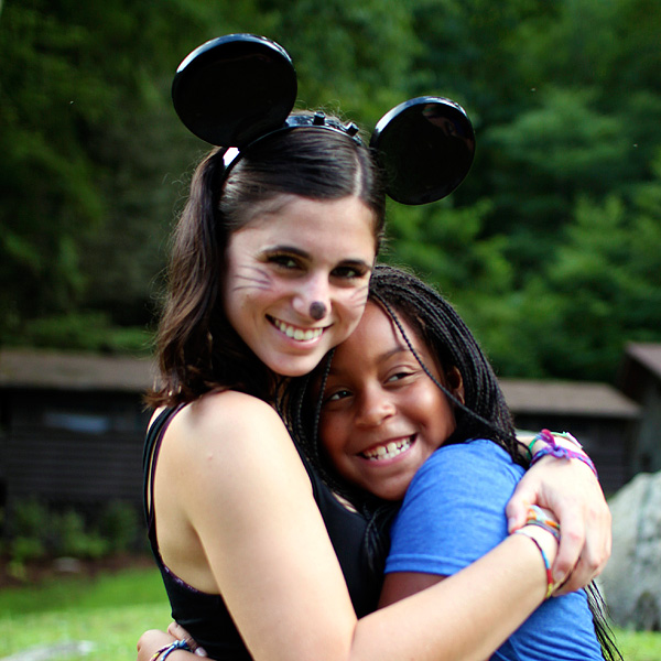 Camp counselor dressed as mini mouse