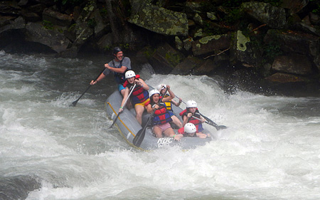 Raft goes over Nantahala river falls