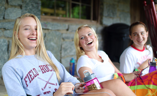 Teen girls happy and laughing at summer camp