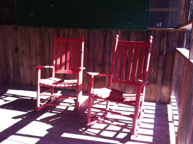 red rocking chairs at camp