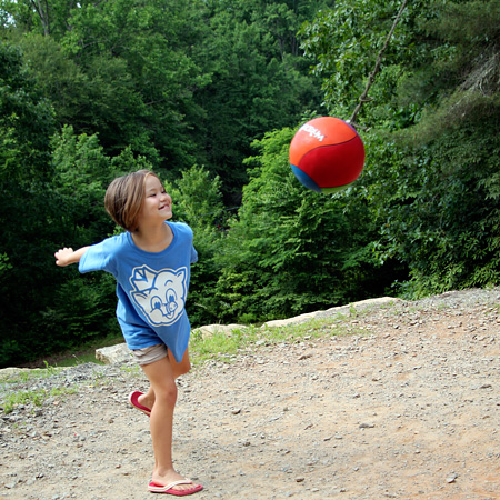 tetherball playing child