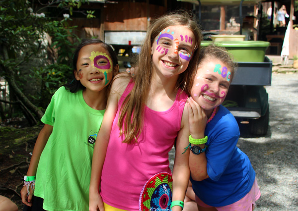 Face painted camp girls