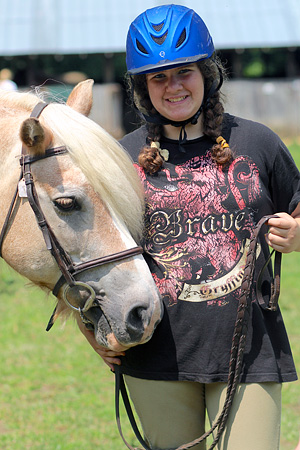 Girl camp camper posing with horse