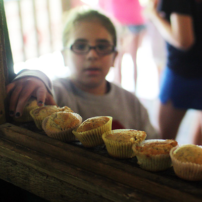 Camp kid eating a fresh muffin