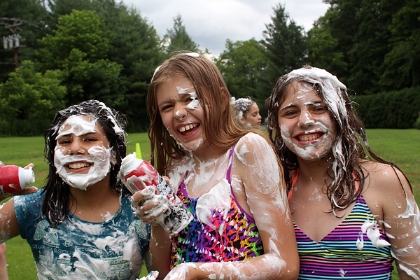 Girls laughing at shaving cream fight