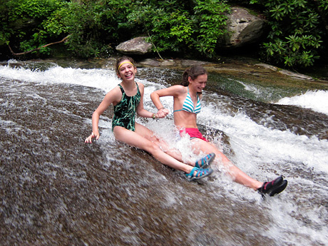 2 camp girls taking a ride down sliding rock