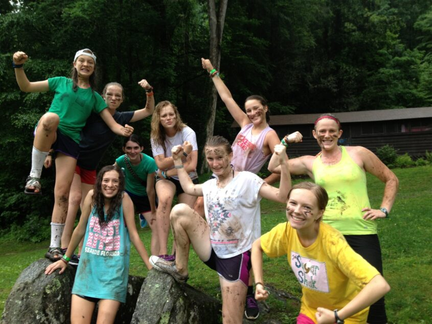 camp girls in the mud