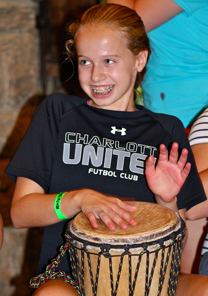 Camp girl learning to drum