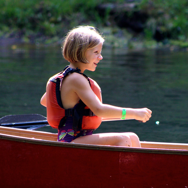 learning to canoe at summer camp