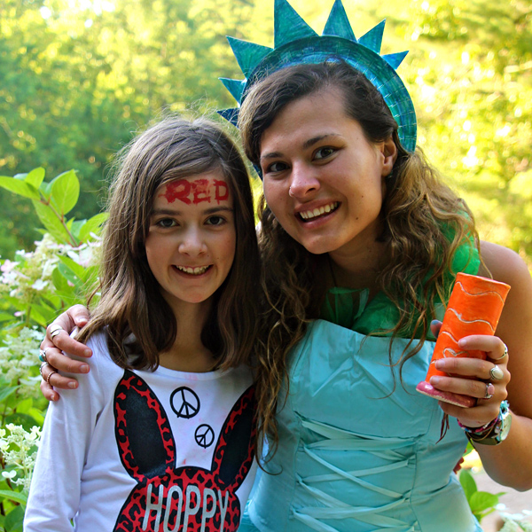 Camp girl with statue of Liberty