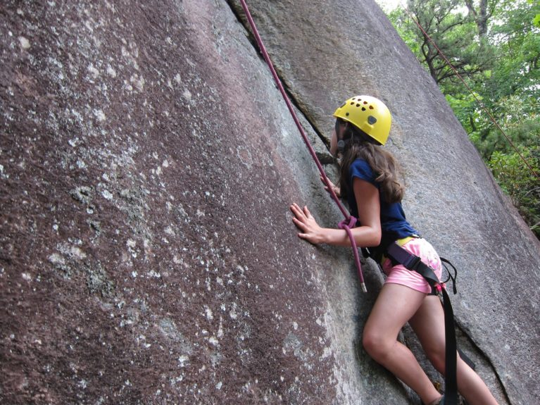 small girl rock climbing