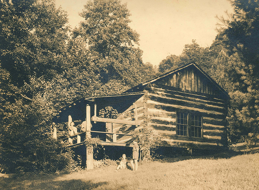 An authentic log cabin at summer camp for girls