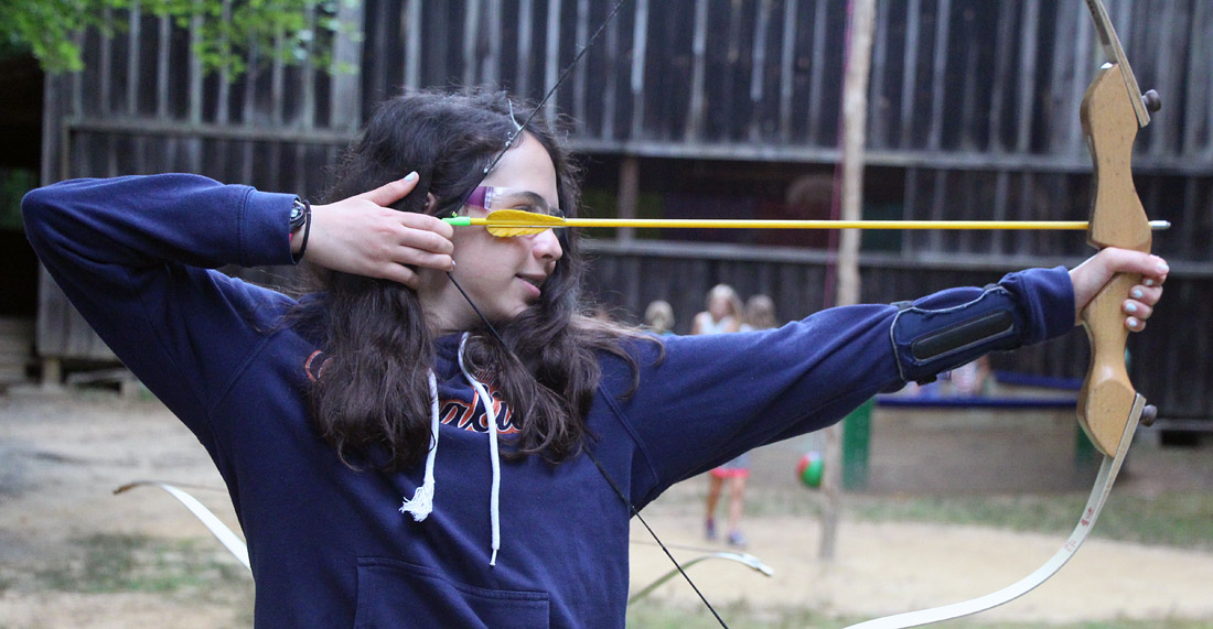 Girl Archer at camp