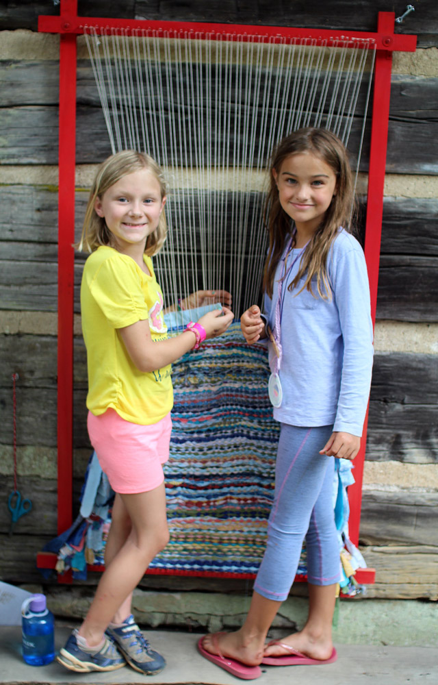 camp girls weaving outside