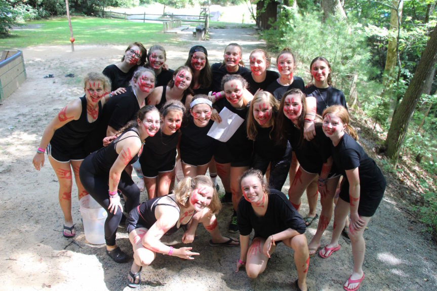 group of camp girls dressed in black