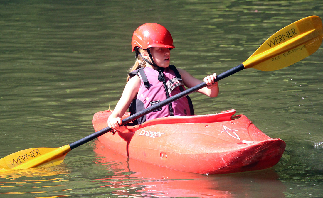 Small child kayaking camp