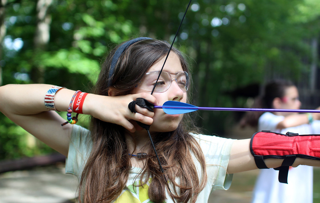 Camp archery girl pulling