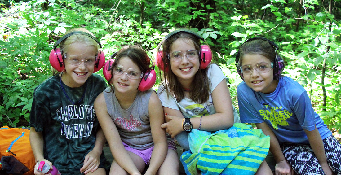 Camp girls with eye and ear protection