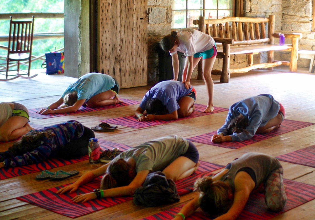 Yoga Kids stretching in group
