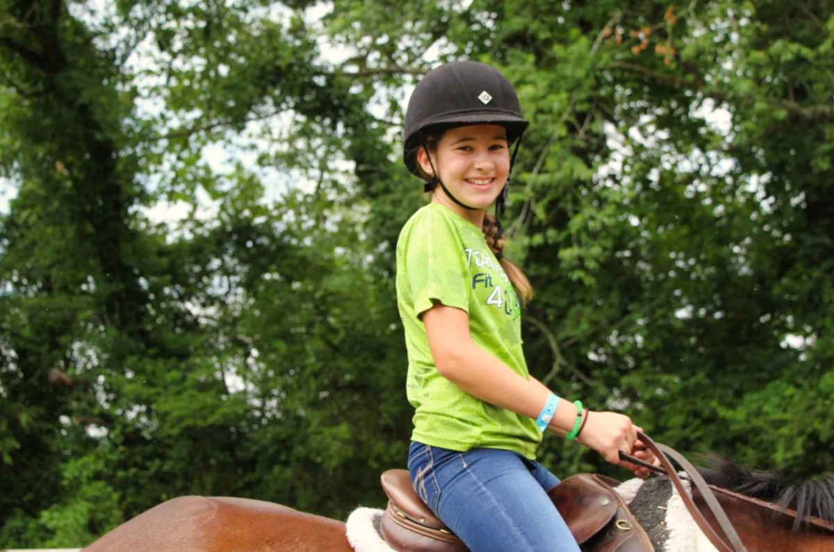 camp girl riding a horse