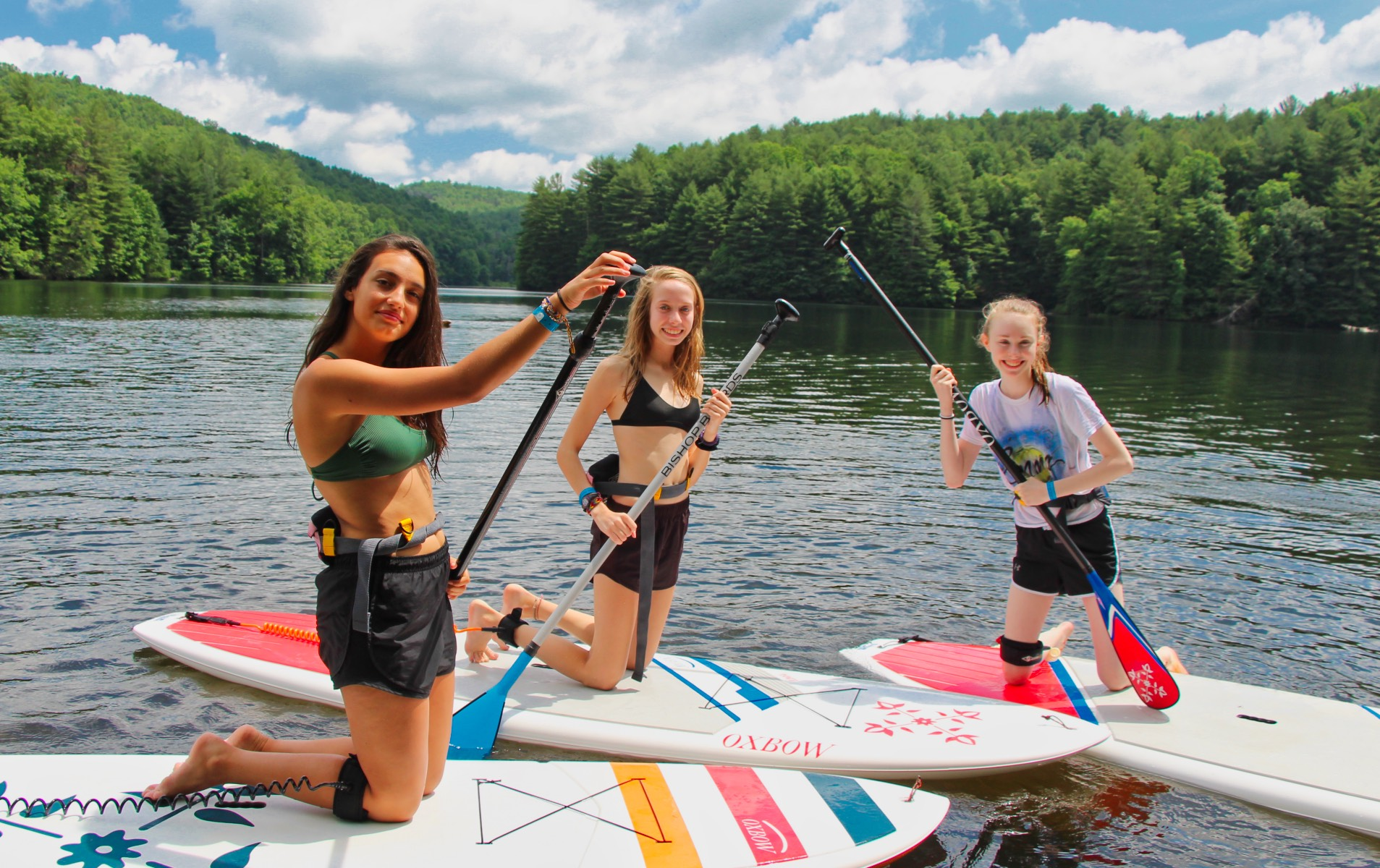 Camp girls paddle boarding