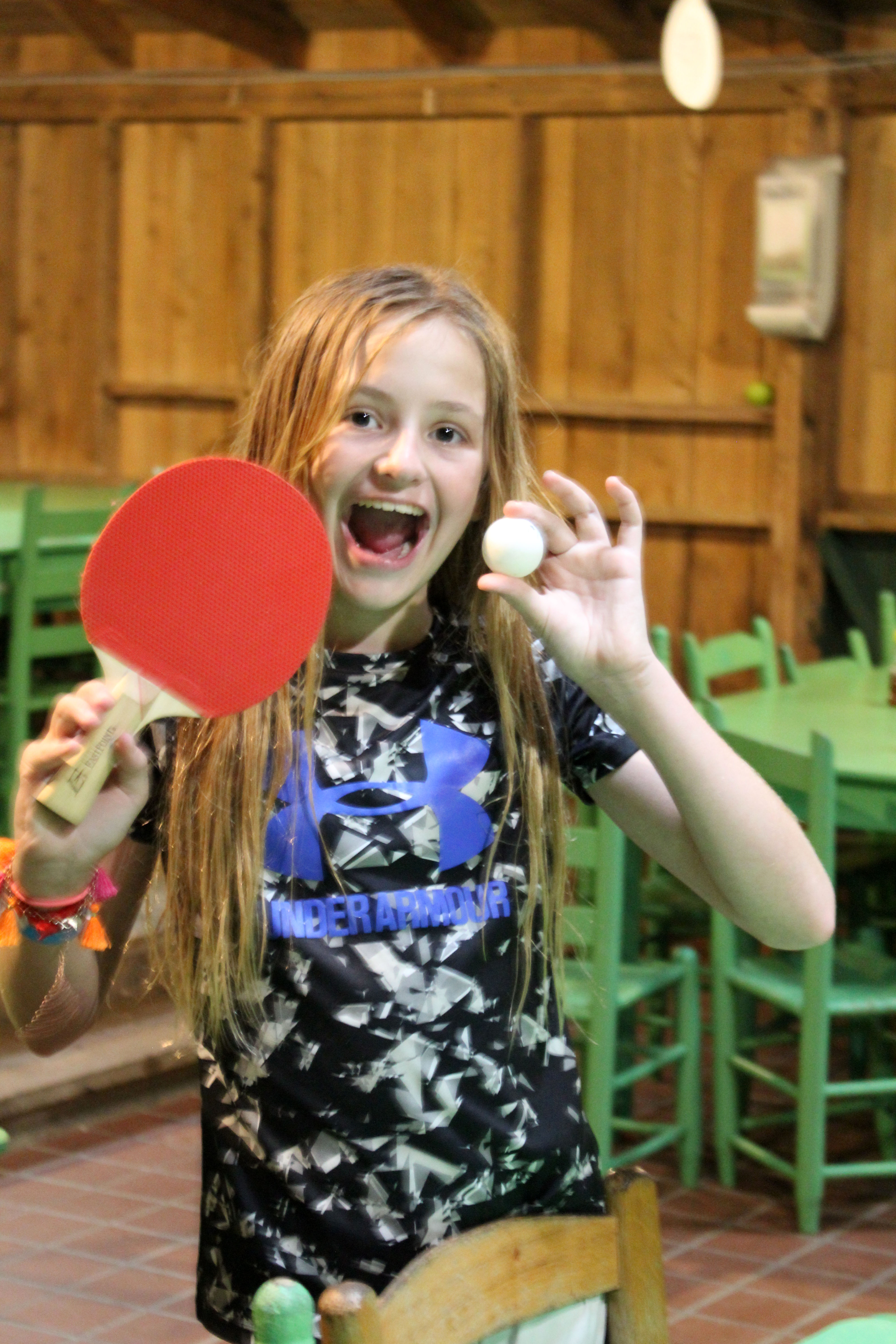 Camp Girl with ping pong paddle and ball