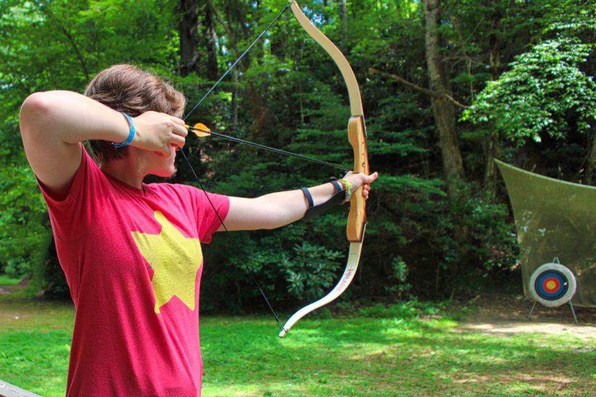 girl archery aiming at target