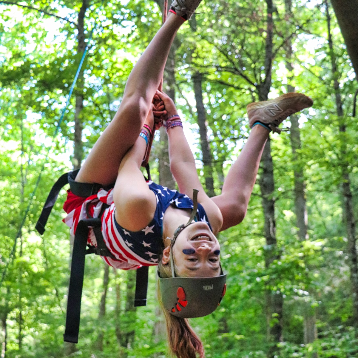 girl on climbing rope for 4th of July