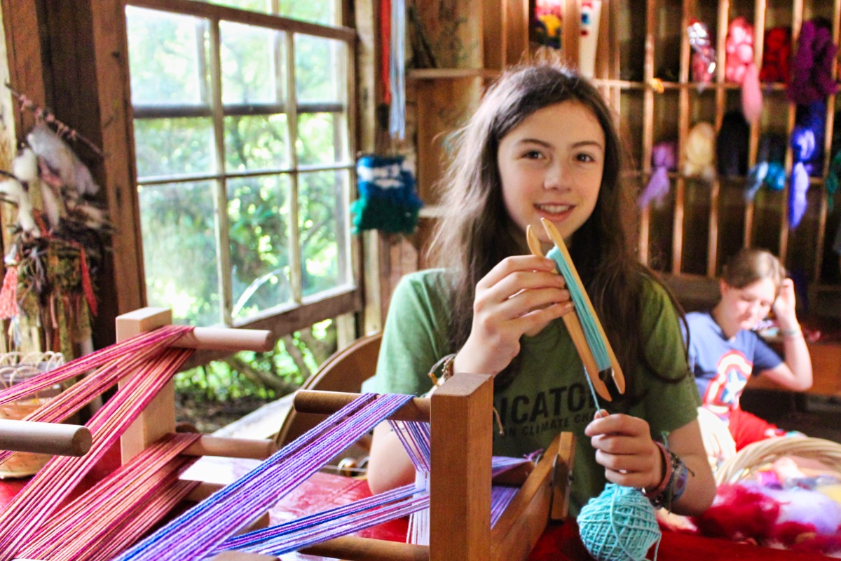 girls wrapping yarn for weaving