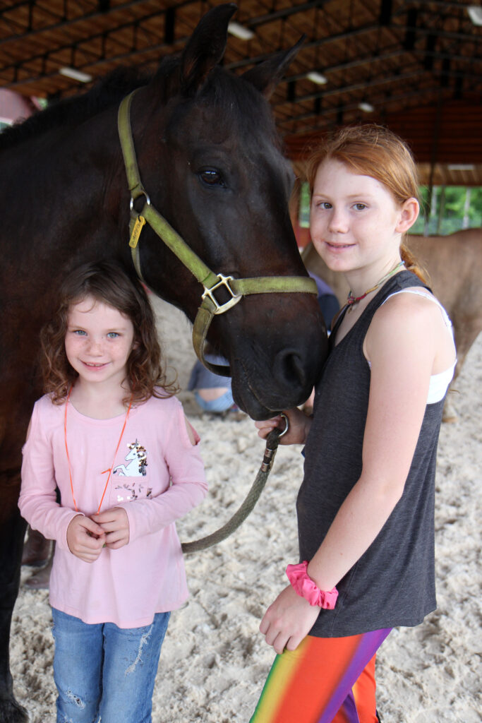 two girls with horse