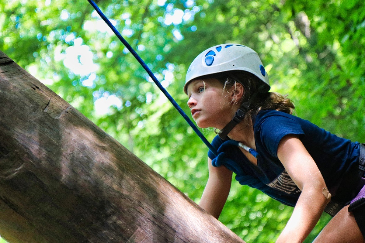 climbing girl dressed in blue