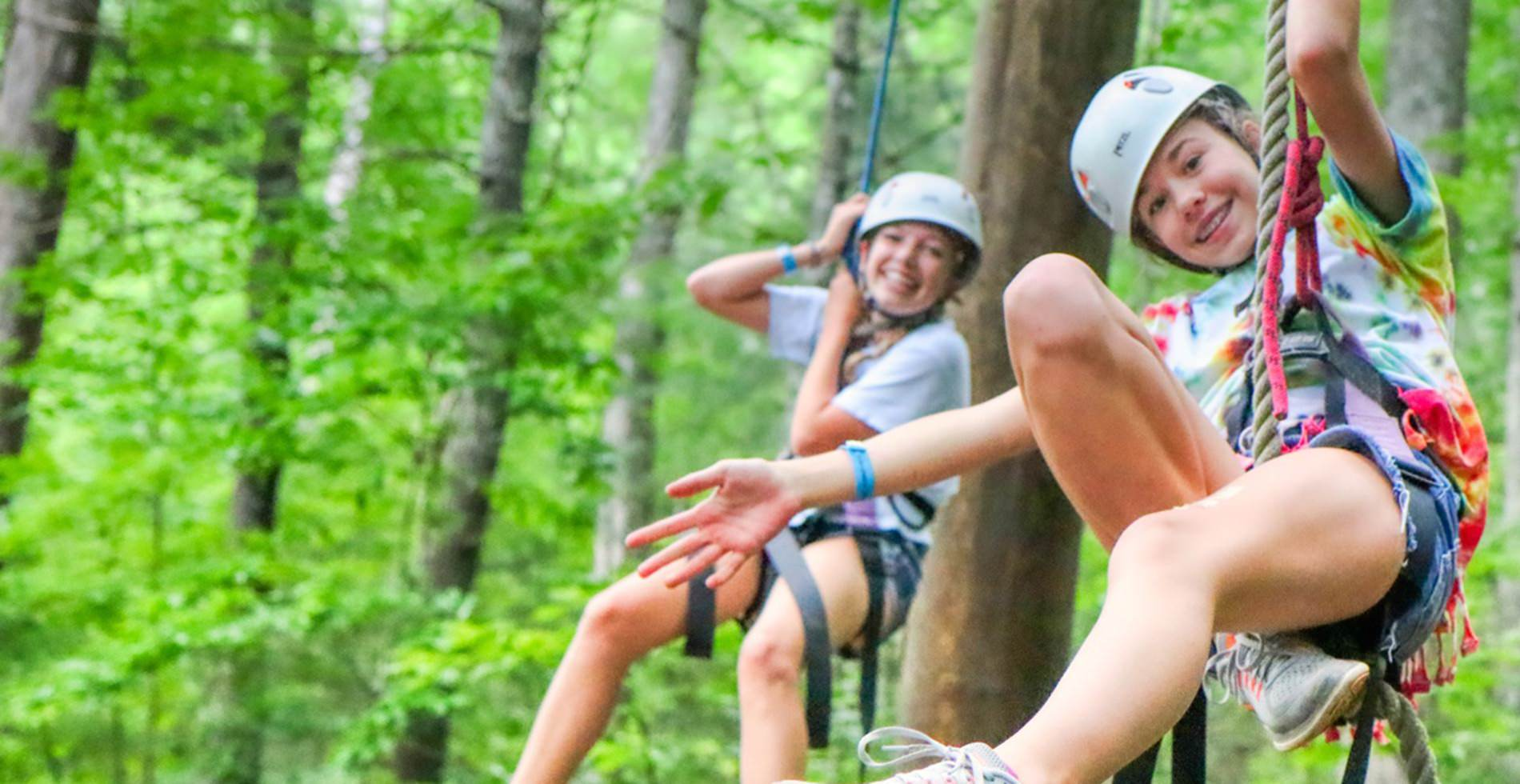 camp girls on climbing ropes