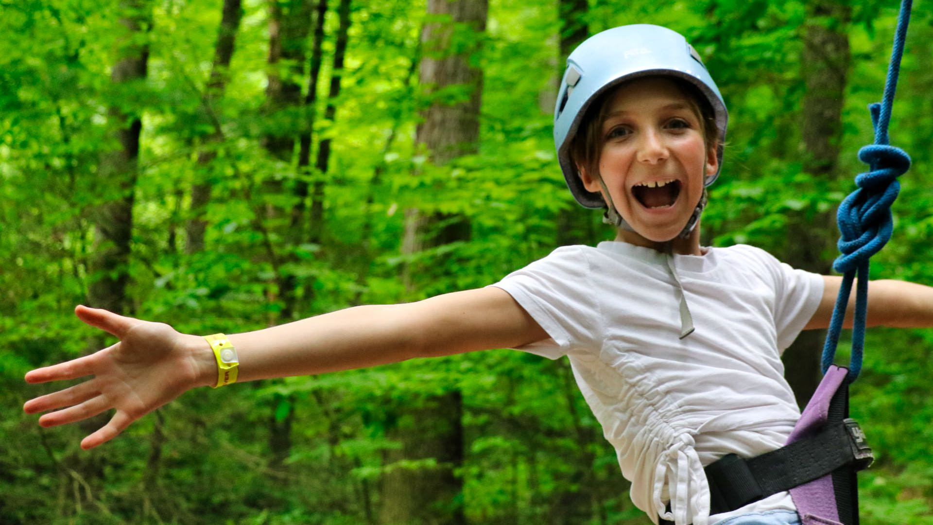 smiling kid climbing at summer camp