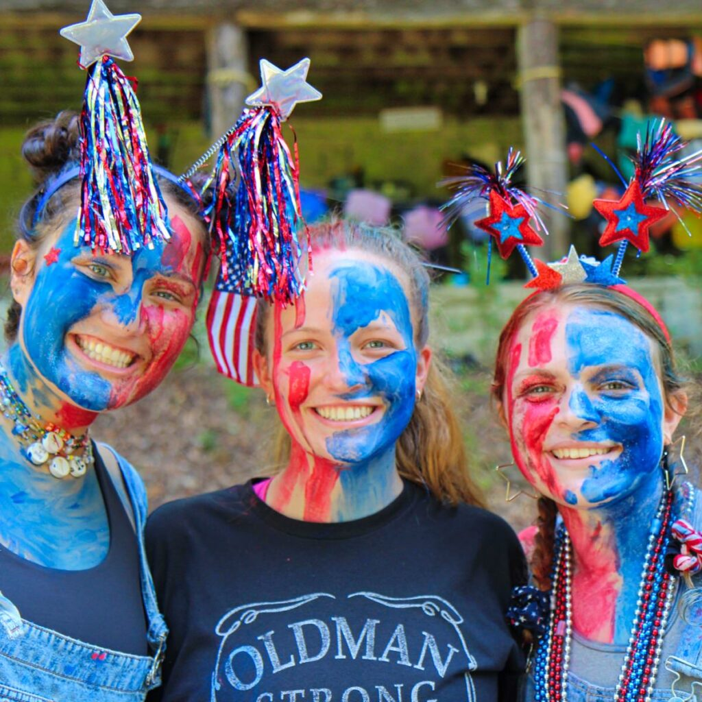 camp counselors painted red white and blue for 4th of July