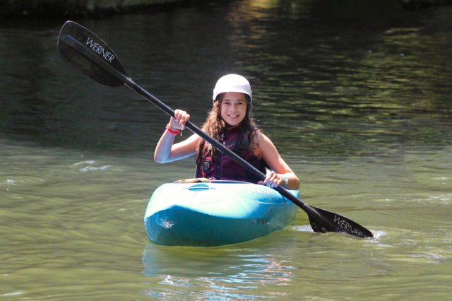 learning to kayak at summer camp