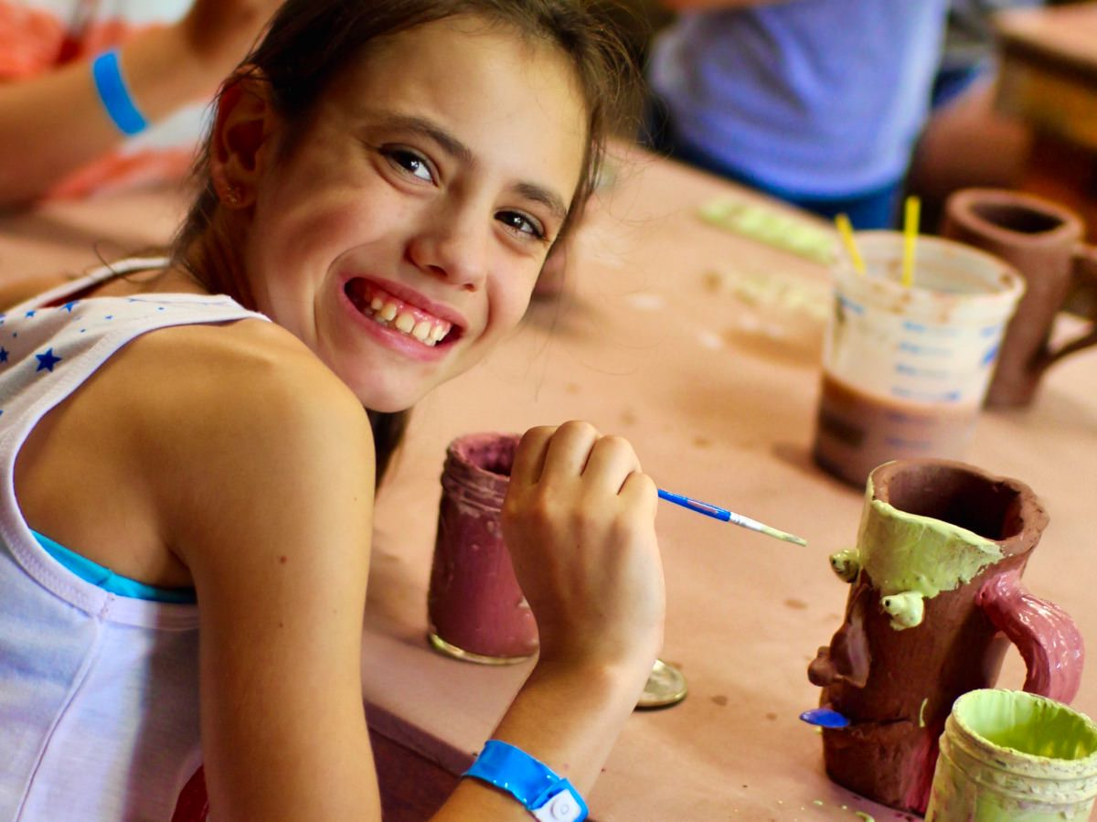 girls making ceramics crafts at camp