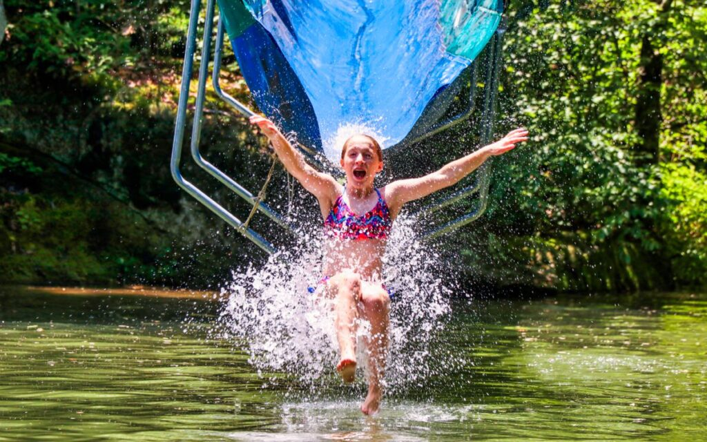 girl camp water slide splash