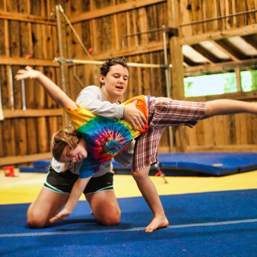 camp staff coaching gymnastics