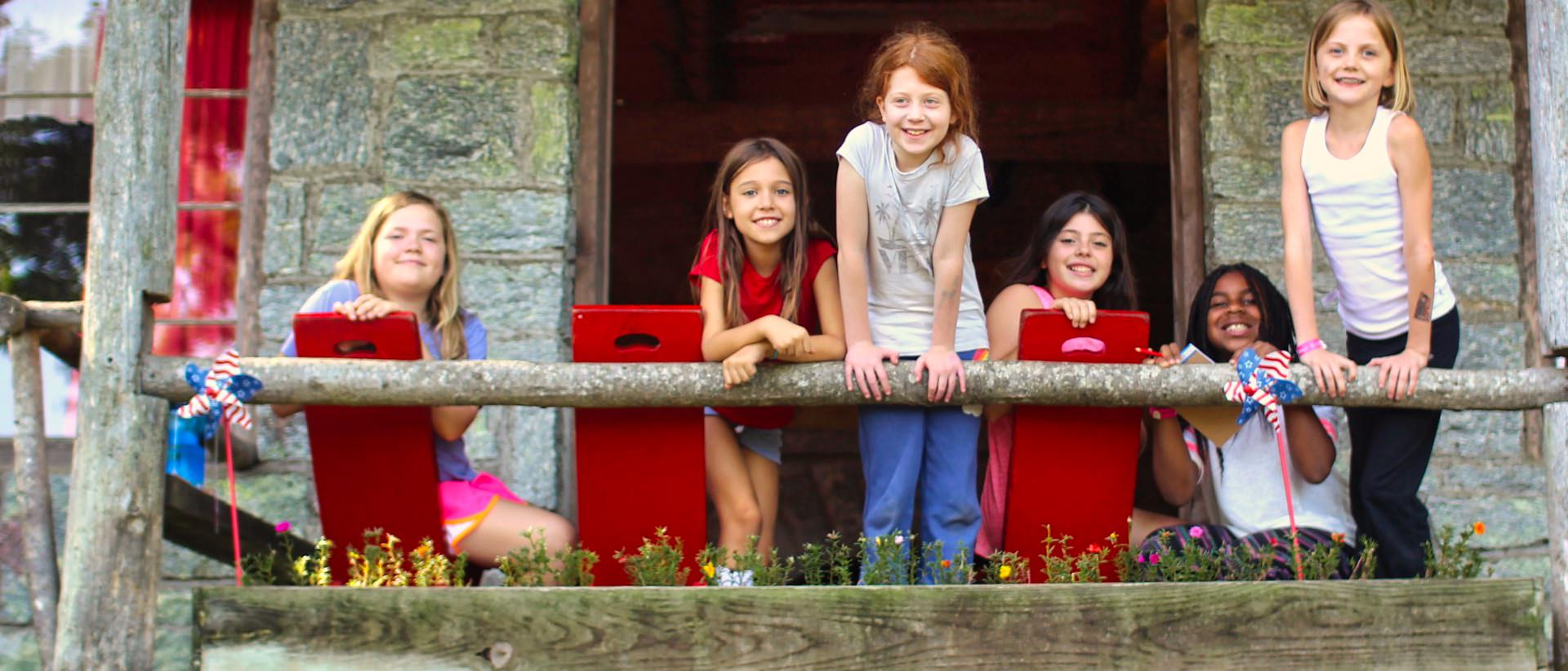 young camp girls on porch